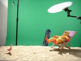 Eskimonika and naked pigeon on set during animation