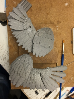 The finished sculpture of the wings for the crow ready for molds