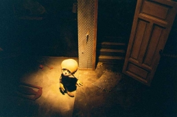 Stop-motion puppet sitting on the floor