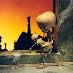 Tungsinn: the main stop-motion puppet character sitting in the window