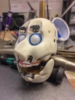 Stop-motion animation head mechanics with silicone teeth
